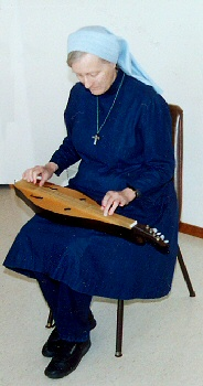 Sister Rebecca Mary playing the dulcimer