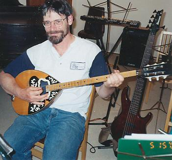 John Hayes is shown playing his bouzouki