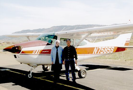 Sister Rebecca Mary and Michael Pape in front of his private plane, a four-seater Cessna.