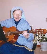 Sister Rebecca Mary plays her guitar